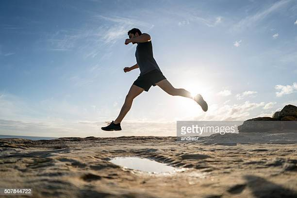 Man running outdoors by the ocean