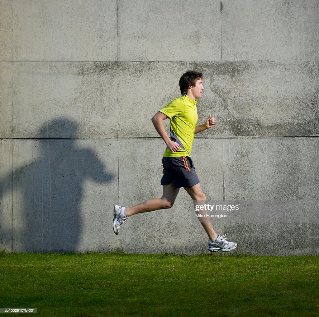Man running, side view : Stock Photo