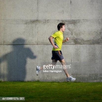 Man running, side view : Stock Photo