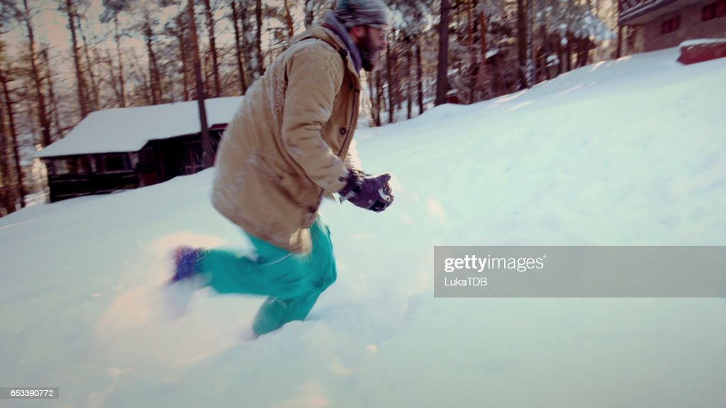 Man running through snow : Stock Photo