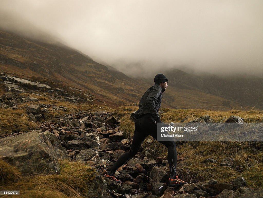 Man running up mountain : Stock Photo