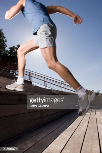 Man running up stairs, close-up : Stock Photo