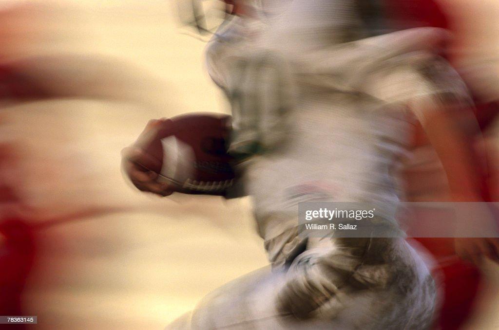 Man running with football : Stock Photo