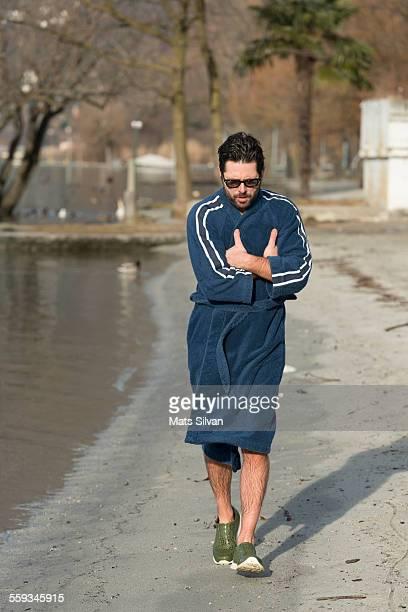 Man running with his bathrobe