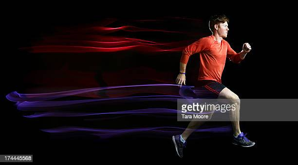 man running with light trails