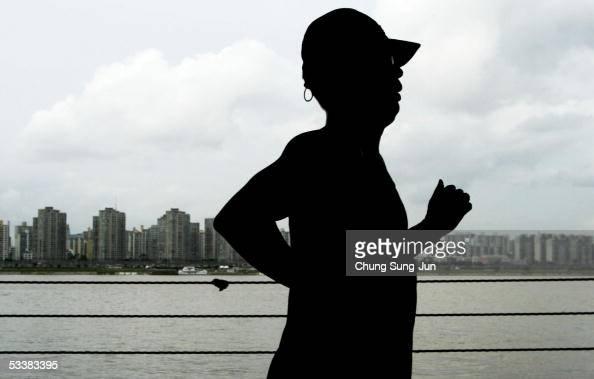 A man runs along the Han River on August 13 2005 in Seoul South Korea