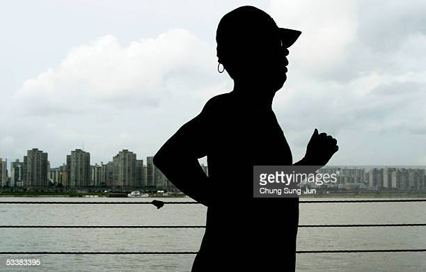 A man runs along the Han River on August 13 2005 in Seoul South Korea