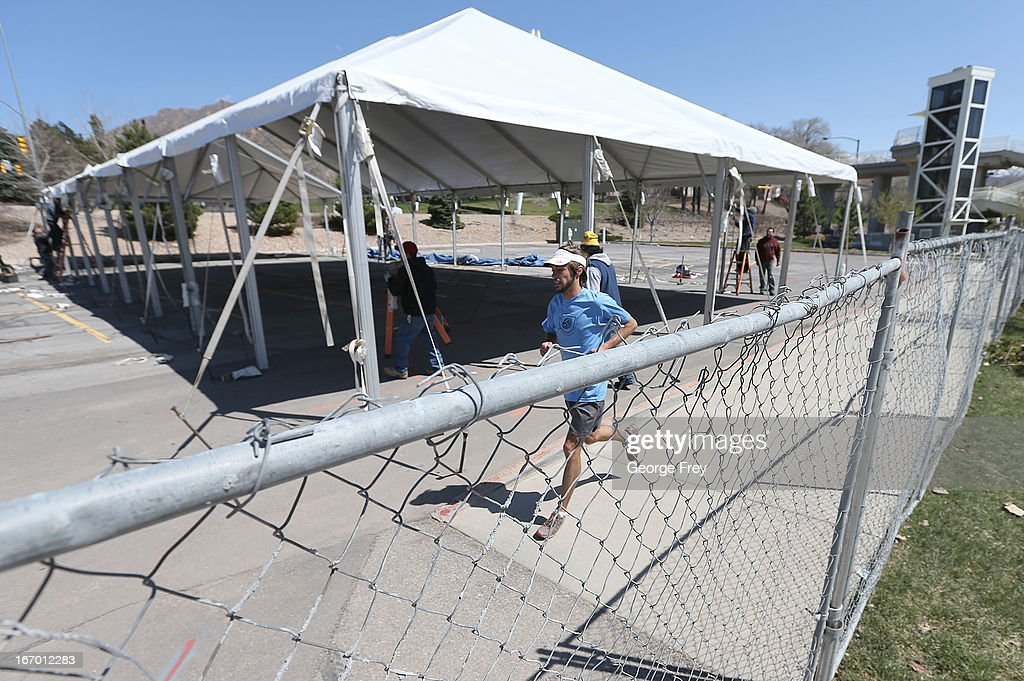 A man runs by security fencing and tents being set up at the starting line of the Salt Lake City Marathon, April, 19, 2013 in Salt Lake City, Utah. The Salt Lake City Marathon is going to be run tomorrow, April 20, 2013 and will be the first major marathon in the U.S. since the Boston Marathon Bombing. Police officials have said security has been dramatically increased since the Boston bombing and is at some the highest levels since the city hosted the 2002 Olympics.