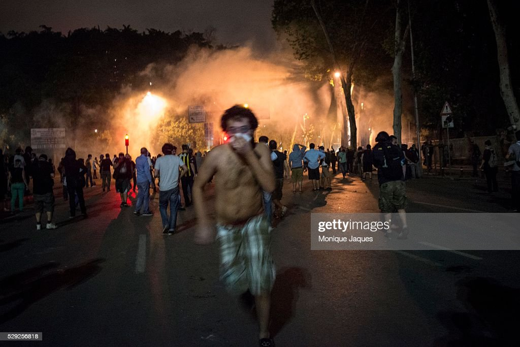 A man runs from tear gas On the 6th day of protests in Istanbul Opposition groups fight in the Dolmabache area of the city where the Prime Ministers...