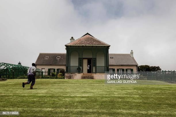 A man runs on the garden of Napoleon last residence during his exile in Longwood on the British Overseas Territory of Saint Helena on October 17 2017...