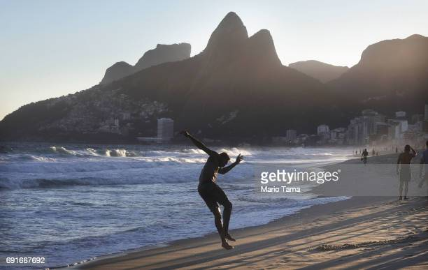 A man runs out of the water at the edge of the Atlantic Ocean on Ipanema beach on June 2 2017 in Rio de Janeiro Brazil According to the Urban Climate...