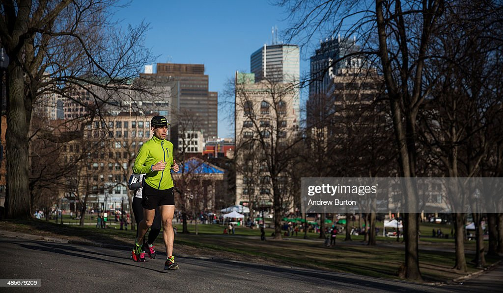A man runs through Boston Common two days before the Boston Marathon on April 19, 2014 in Boston, Massachusetts. This year's marathon will be held on Monday, April 21; last year two pressure cooker bombs were detonated near the finish line, killing three people and injuring more than 260 others.
