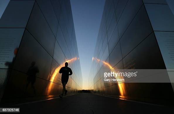A man runs through the Empty Sky 9/11 memorial at sunset in Liberty State Park on January 1 2017 in Jersey City NJ