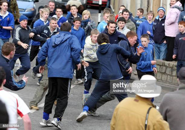 A man runs with the ba as two teams take part in the annual HandBa' match held in the streets of Jedburgh to celebrate the Fastern Eve HandBa festival