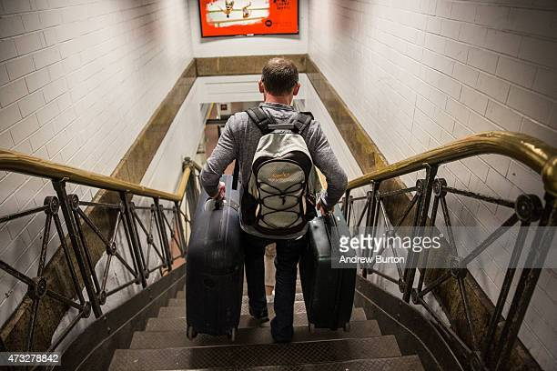A man rushes to catch the NJ Transit train from New York Penn Station to Trenton NJ on May 14 2015 in New York City An Amtrak train crash in...