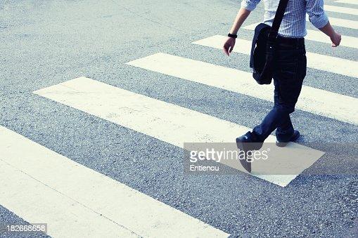 Man rushing across zebra crossing