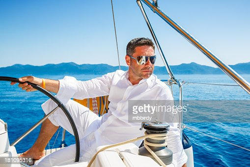 Man sailing with sailboat