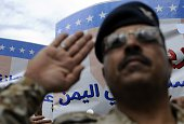 A man salutes as Houthi supporters stage a protest claiming that the United States obstructs the peaceful settlement in Yemen at Babul Yemen street...