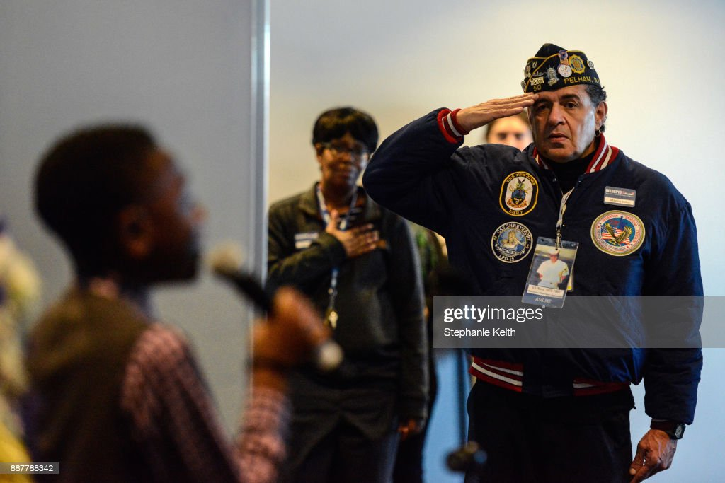 A man salutes during a wreath-laying ceremony aboard the Intrepid Sea, Air and Space Museum the on December 7, 2017 in New York City. The ceremony commemorates the 76th anniversary of the attack on Pearl Harbor.