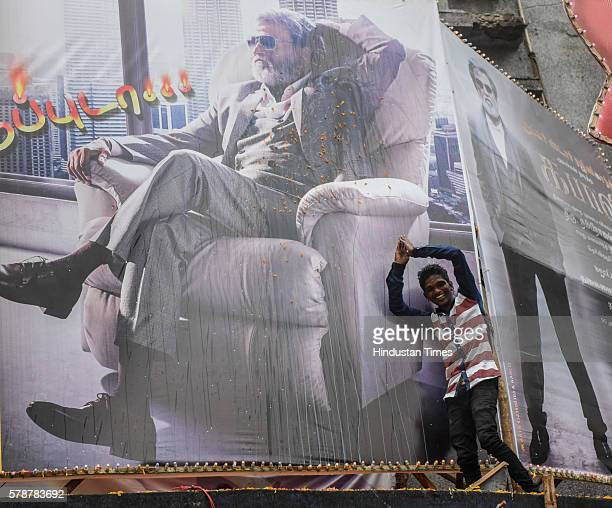 A man salutes towards the banner of Rajinikanth at Aurora Cinema Matunga on July 22 2016 in Mumbai India It was a sleepless night for the most...