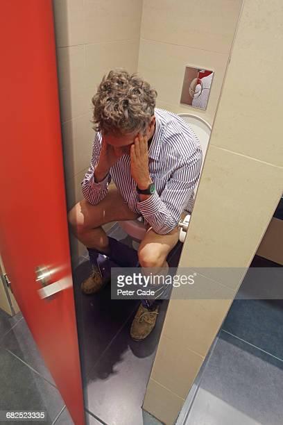 Man sat on public toilet