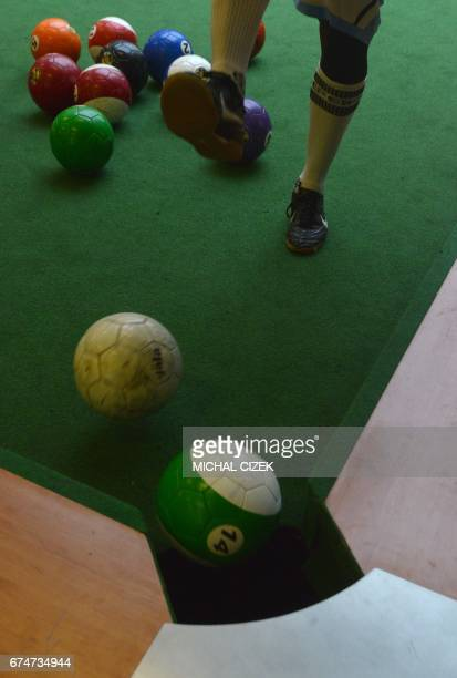 A man scores during a footballpool match on April 28 2017 in Prague Footballpool is a combination of football and pool the sport uses inflatable...