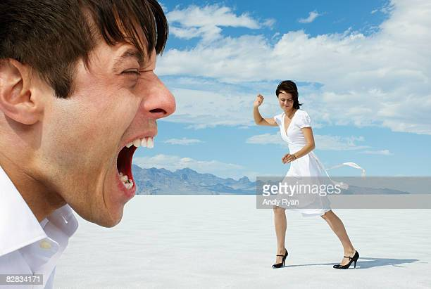 Man Screaming at Woman on Salt Flats