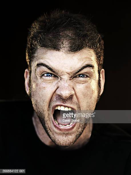 Man screaming, close-up, portrait
