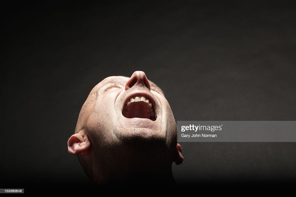 man screaming looking up