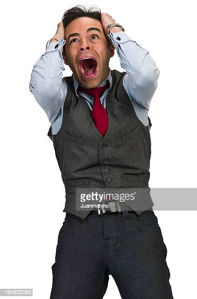 man screaming with his hands on his head