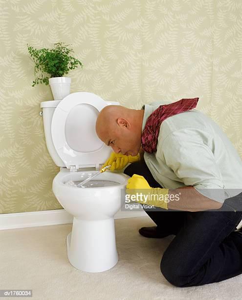 Man Scrubbing a Toilet