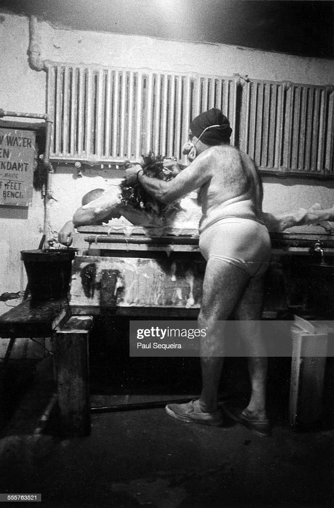 exceptional luxor baths #5: A man scrubs the back of a patron at the Luxor Baths on North Avenue on