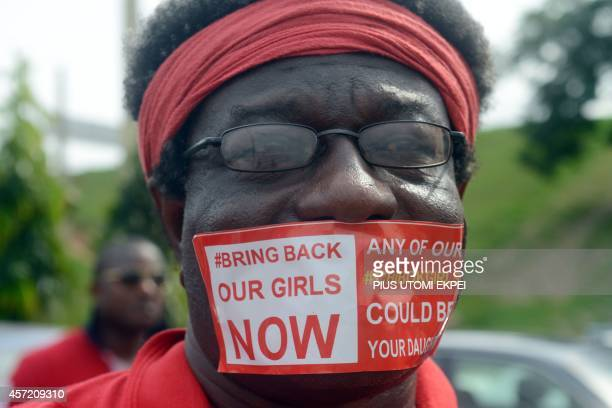 A man seals mouth with a branded sticker reading 'Bring Back Our Girls Now' to campaign for the release of the kidnapped Chibok schoolgirls during a...