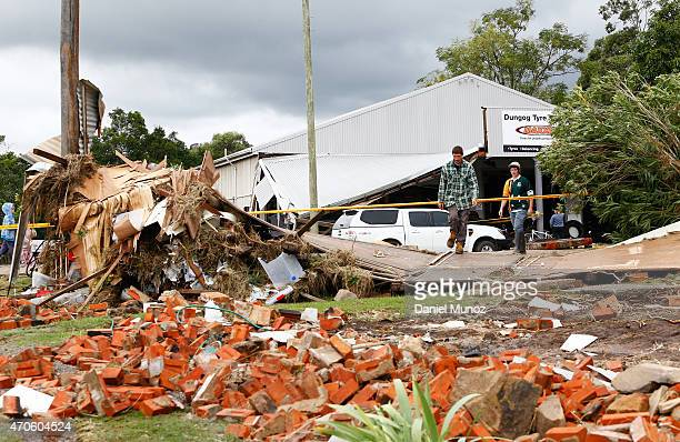 A man search for goods among the debris of a house destroyed by cyclonic winds on April 22 2015 in Dungog Australia Three people have died and more...