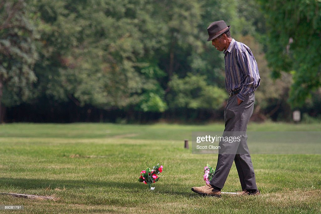 A Man Searches For Grave At Mount Glenwood Memory Gardens Cemetery July 27 2009