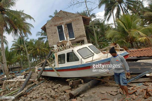 A man searches for his belongins from the remains of his destroyed house in Pangandaran 20 July 2006 threedays after strong earthquaketriggered...
