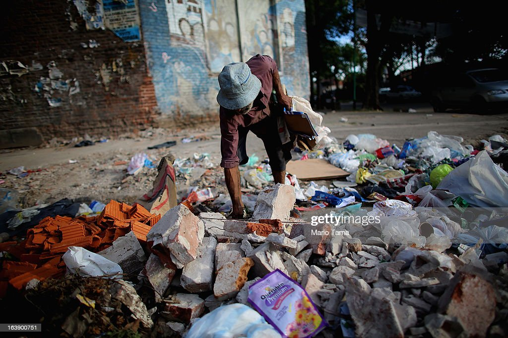 A man searches for items to recycle near the Virgin of the Miracles of Caacupe church following Sunday Mass in the Villa 21-24 slum, where archbishop Jorge Mario Bergoglio, now Pope Francis, used to perform charity work, on March 17, 2013 in Buenos Aires, Argentina. Francis was the archbishop of Buenos Aires and is the first Pope to hail from South America. Some locals are now affectionately calling Francis, known for his charity work in the slums, the 'slum pope.'