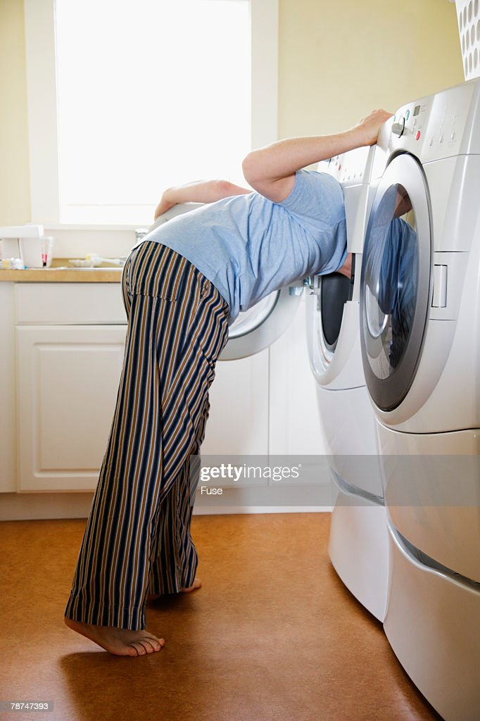 Man Searching in His Wash Machine