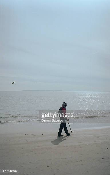 Man searching the beach with metals detector