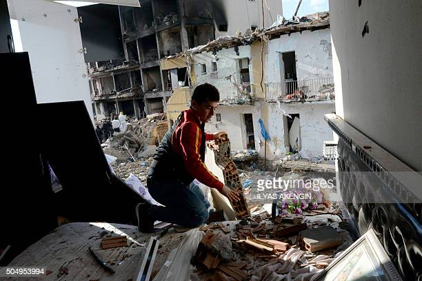 A man searchs through the wreckage of a blast damaged building on January 14 2016 in Diyarbakir Six people died and 39 others were wounded in a car...