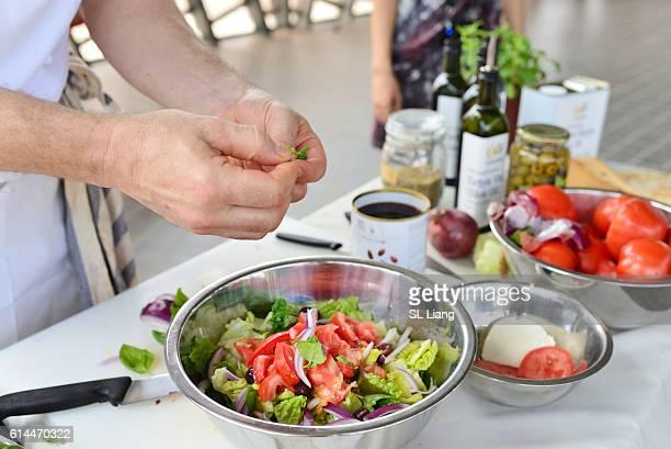 man seasoning tomato salad (salad cooking lesson)