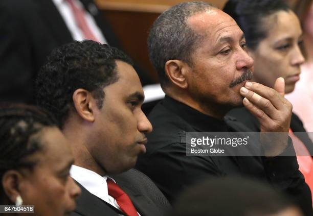 A man seated in area reserved for families listens to testimony of Boston Police Officer Luciano Cirino Ayuso during the double murder trial of...