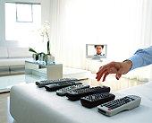 Man selecting remote control handset