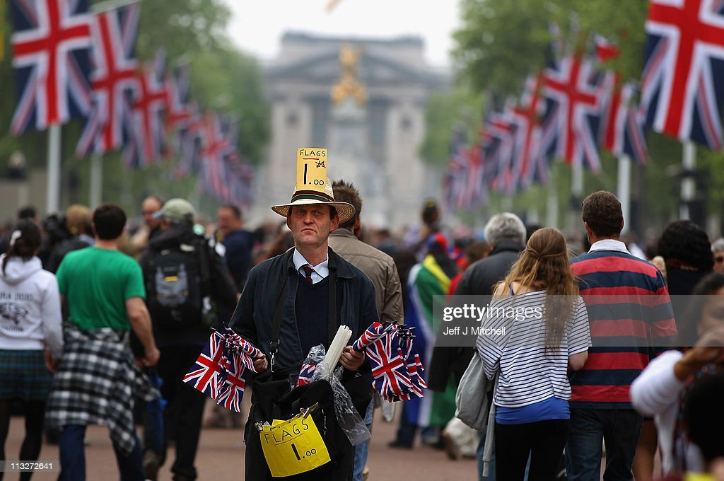 A man sell flags as well-wishers move along the Mall towards Buckingham Palace to celebrate the Royal Wedding of Prince William, Duke of Cambridge and Catherine, Duchess of Cambridge at Westminster Abbey on April 29, 2011 in London, England. The marriage of the second in line to the British throne is to be led by the Archbishop of Canterbury and will be attended by 1900 guests, including foreign Royal family members and heads of state. Thousands of well-wishers from around the world have also flocked to London to witness the spectacle and pageantry of the Royal Wedding.