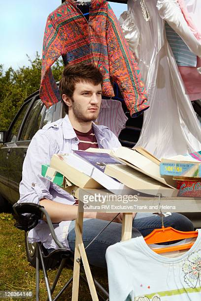 Man selling books from car trunk