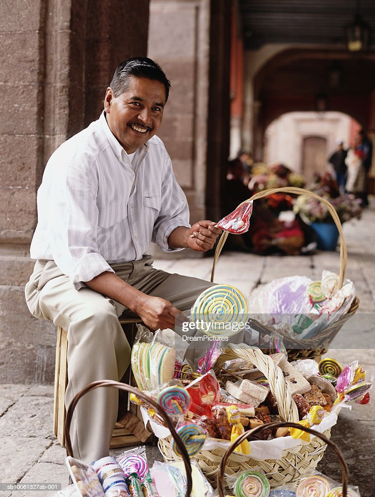 Man selling candy in street, Portrait