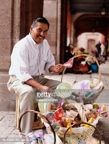 Man selling candy in street, Portrait