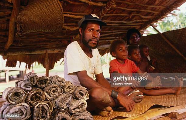 Man selling crocodile skins