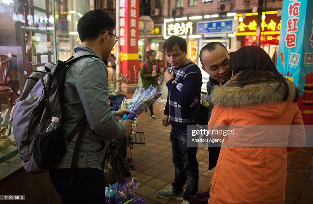 A man selling flowers for lovers on February 14, 2016 in Xiamen,China. Valentine's Day, also known as Saint Valentine's Day or the Feast of Saint Valentine is observed on February 14 each year. It is celebrated in many countries around the world, although it is not a public holiday.