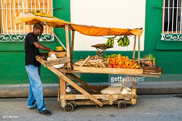 Man selling fruits and vegetables on street, Santiago de Cuba